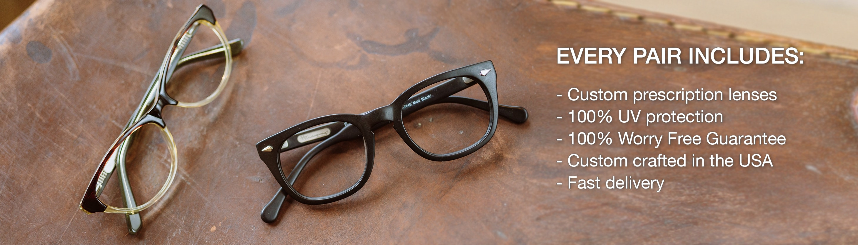 Two plastic frames. One black and the other one is tortoise that fades to a transluscent yellow