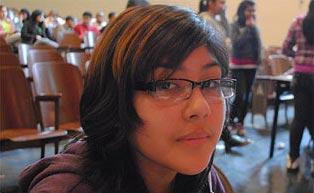 girl in school wearing semi rimless frames
