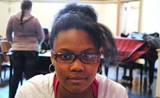 girl in school wearing plastic frame