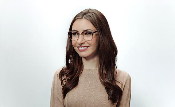 woman smiling and wearing glasses