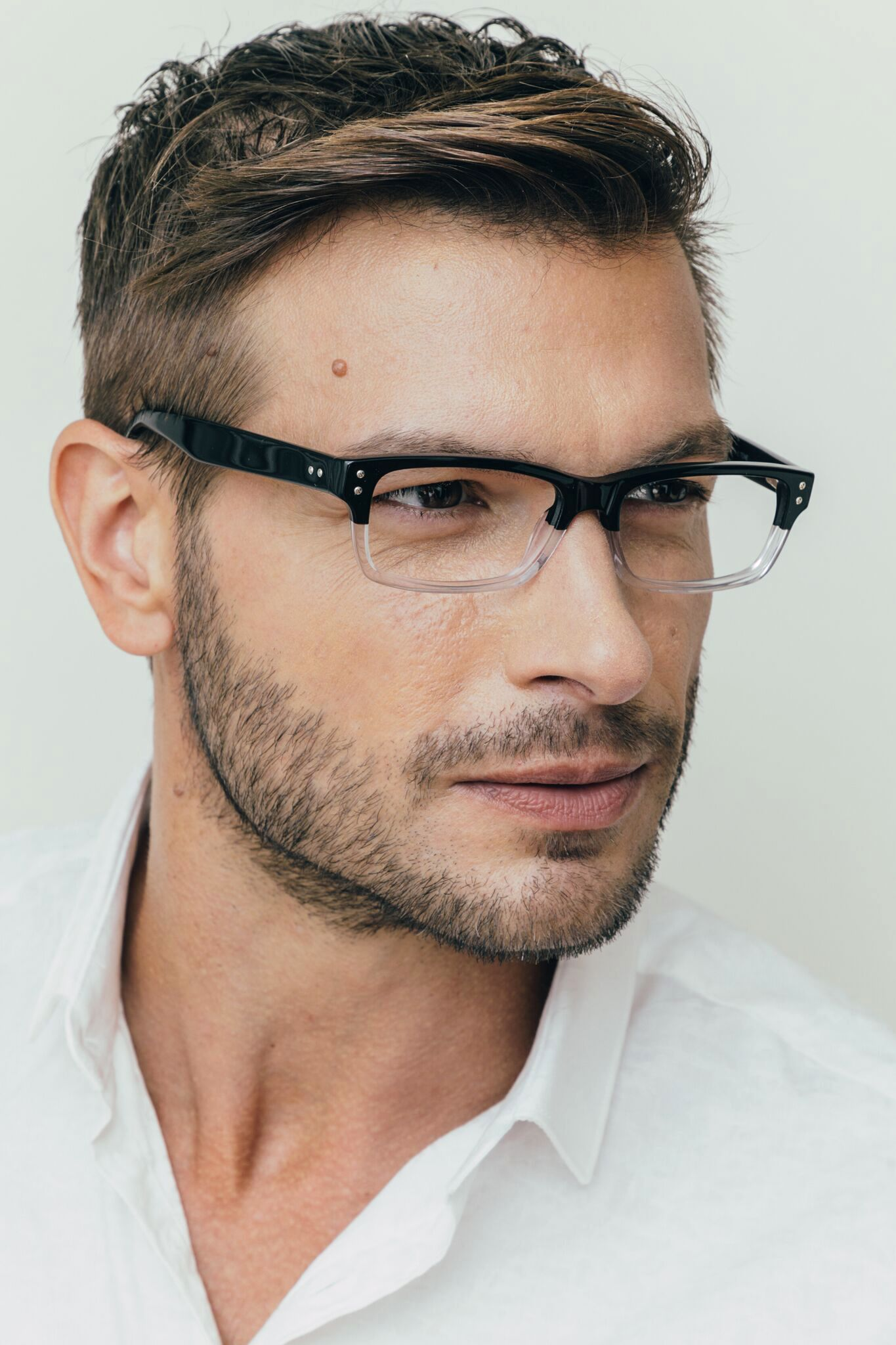 Brunette male wearing plastic ernest hemingway black/clear 4613 frame