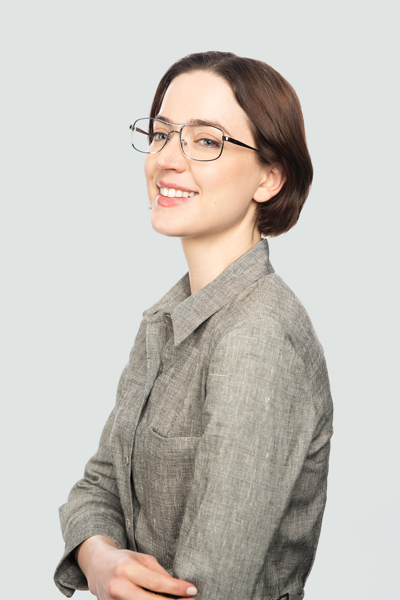 brunette woman wearing metal glasses