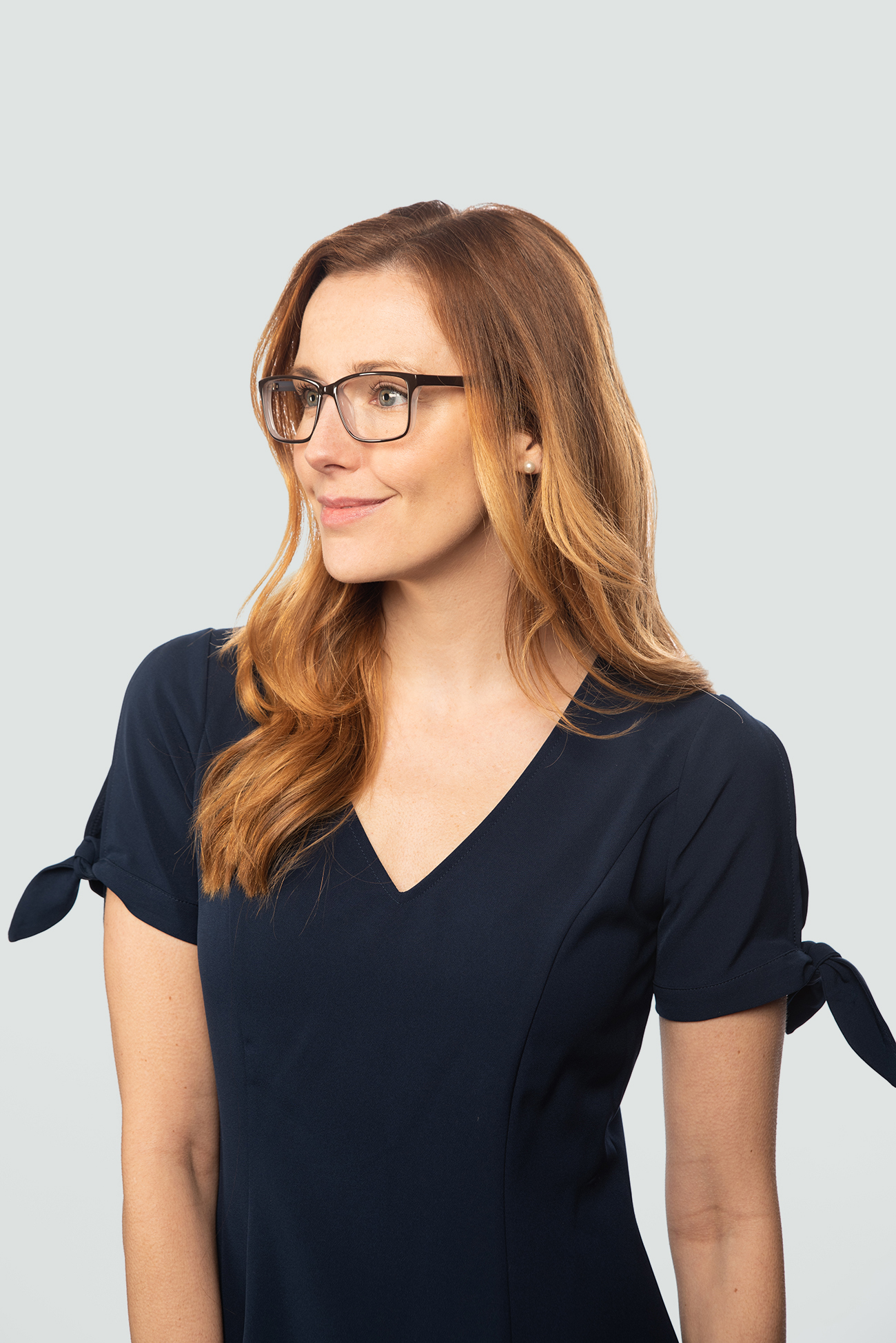 red haired woman plastic black glasses