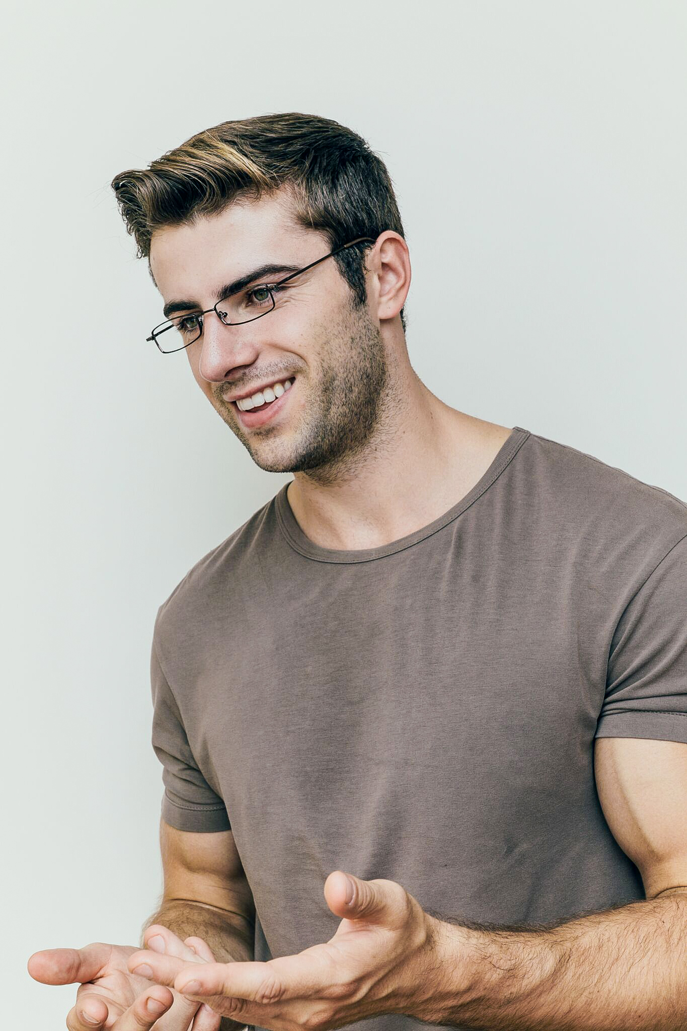 brunette man wearing metal brown glasses