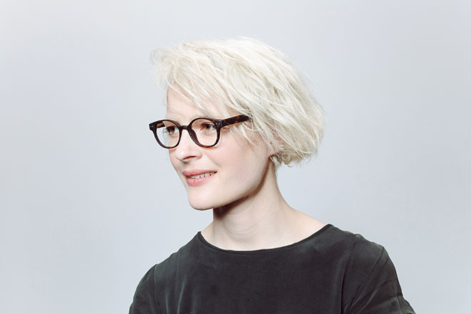 blonde haired woman wearing black glasses