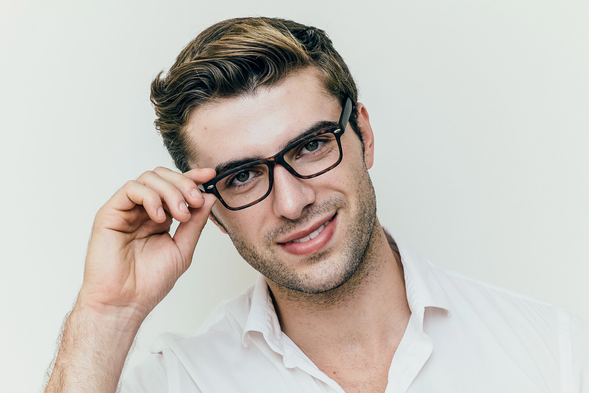 brunette man wearing matte black glasses