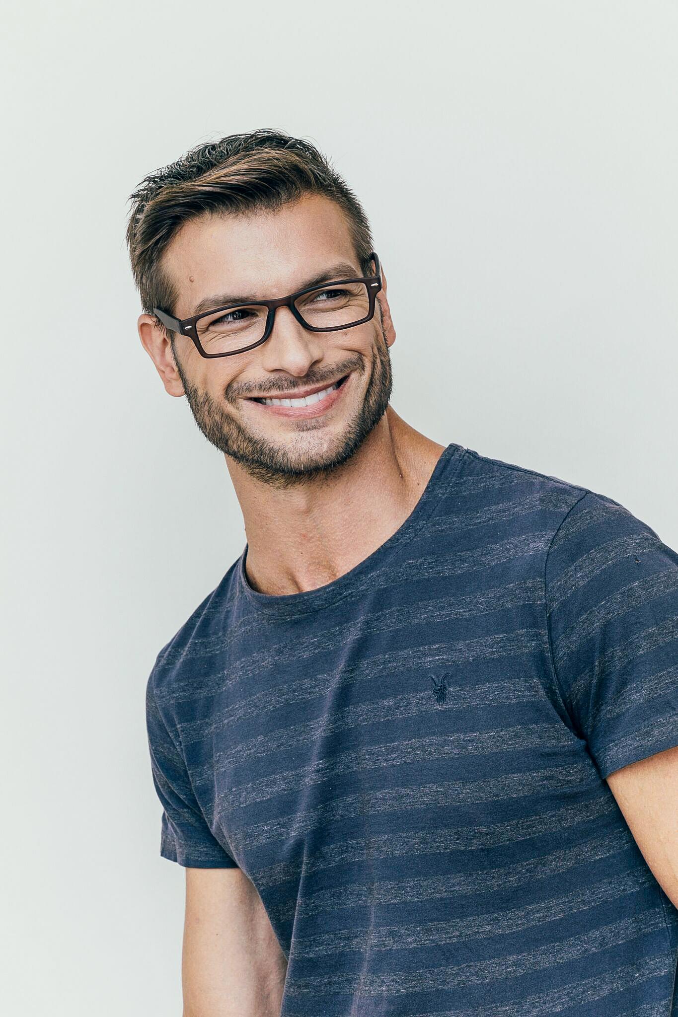 brunette man wearing matte black glasses
