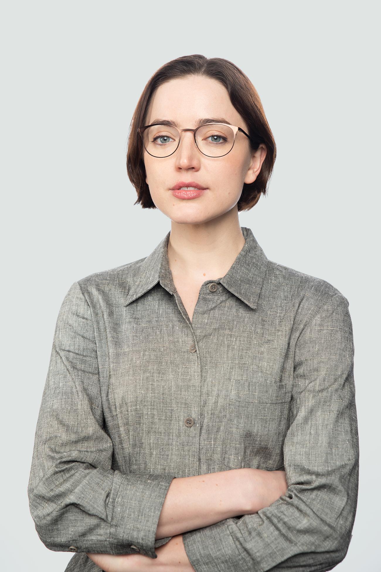 brunette woman wearing metal brown glasses