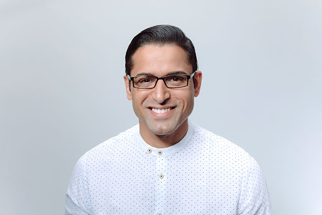 black haired man wearing black plastic glasses