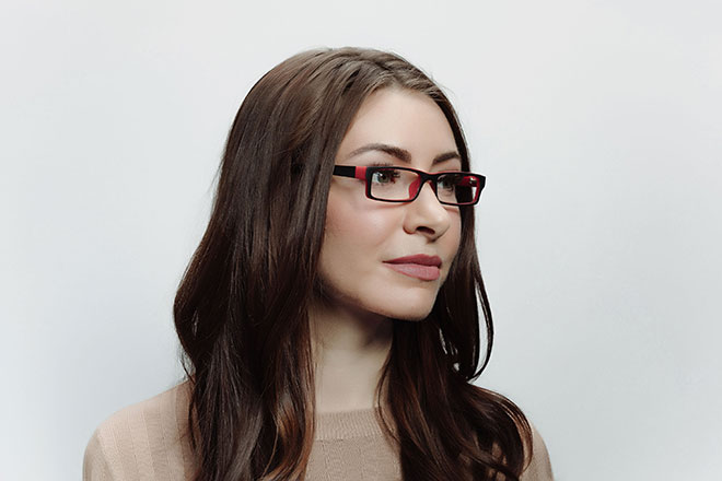 Brunette female wearing plastic Black/red Argon frame