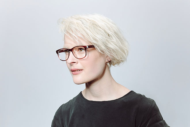 blonde hair woman wearing plastic brown glasses