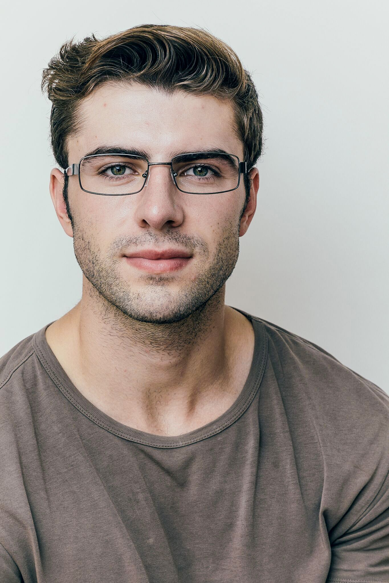 brunette man wearing gray metal glasses