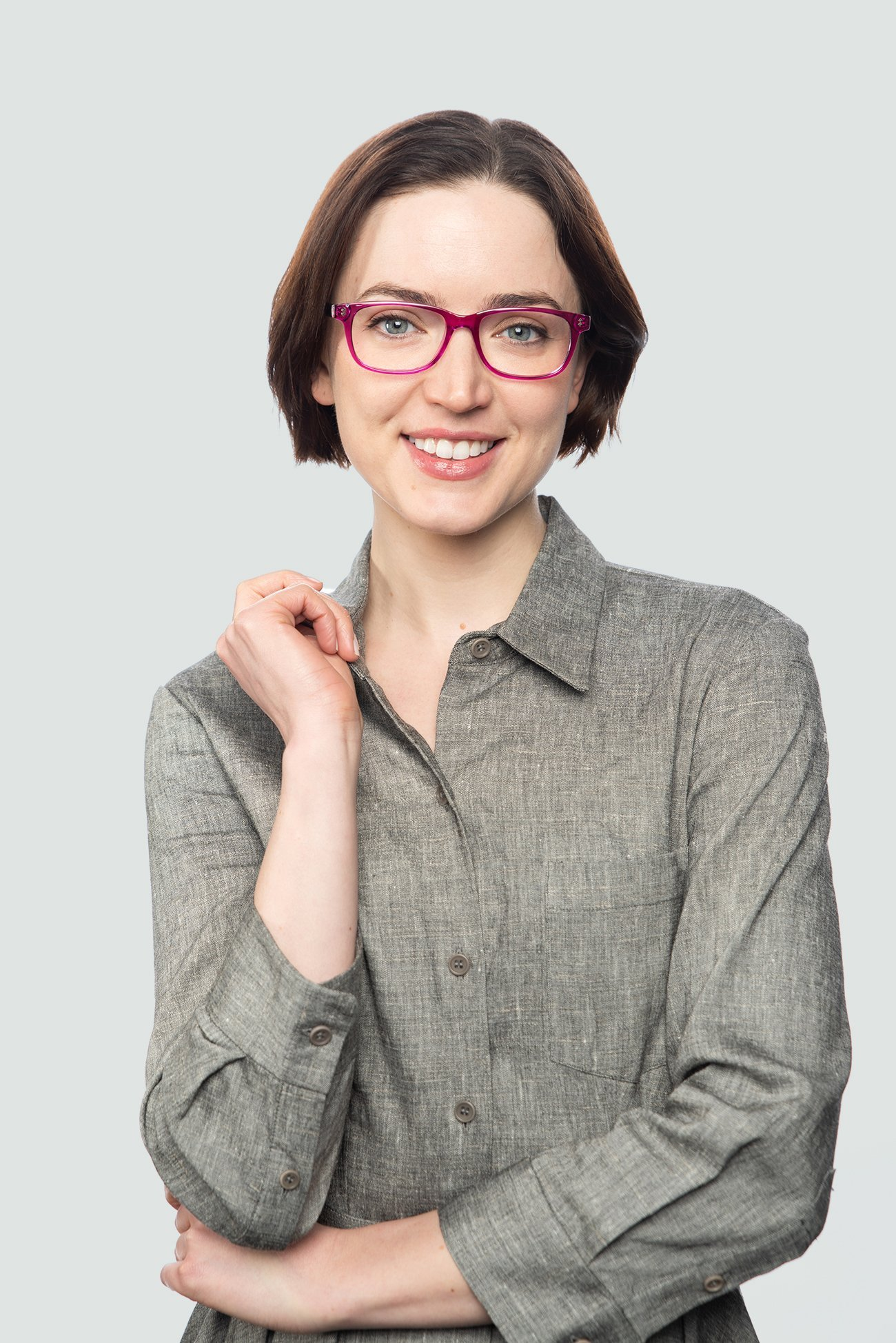 brunette woman wearing pink crystal glasses