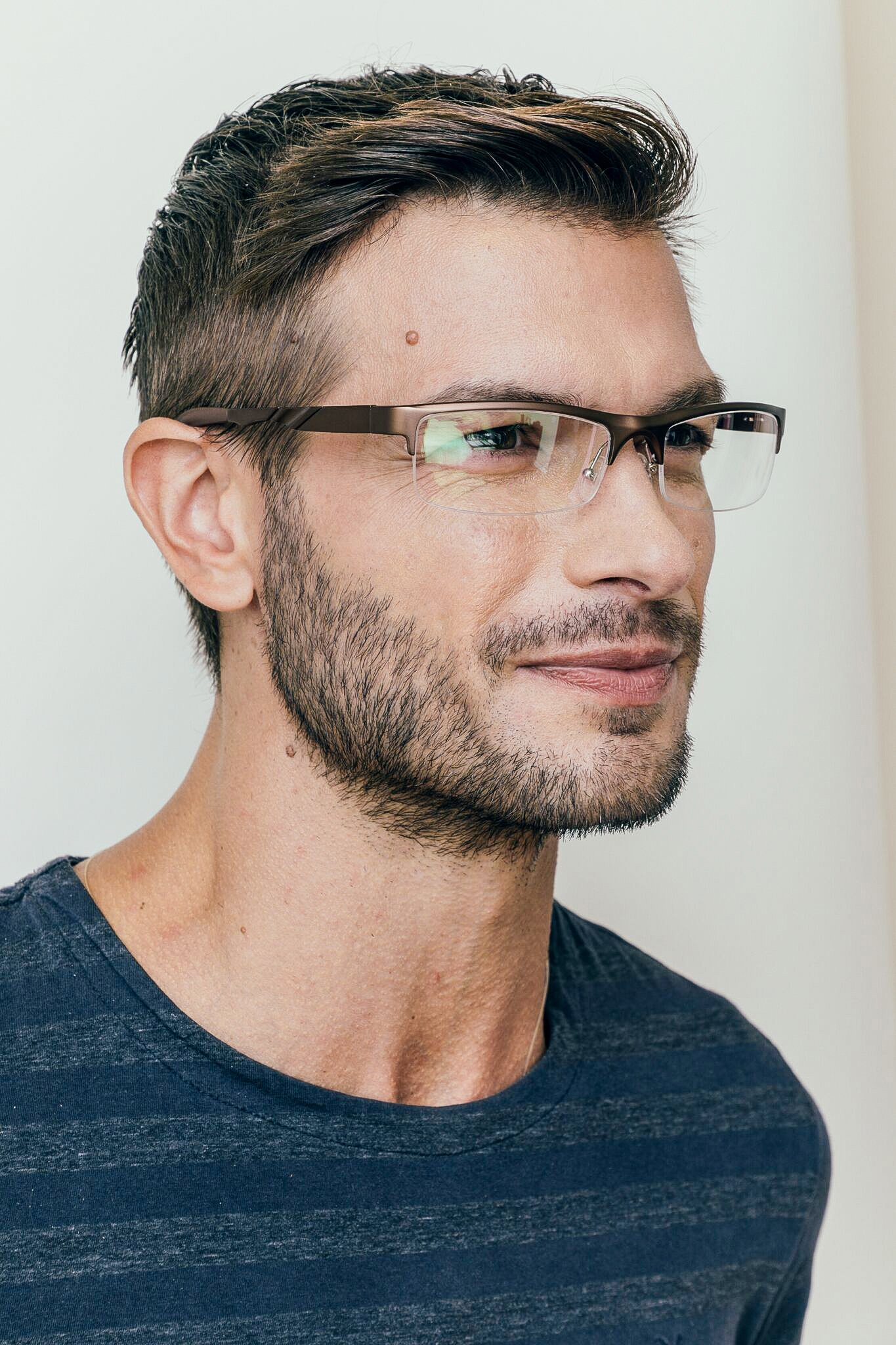 brunette man wearing brown metal semi-rimless glasses