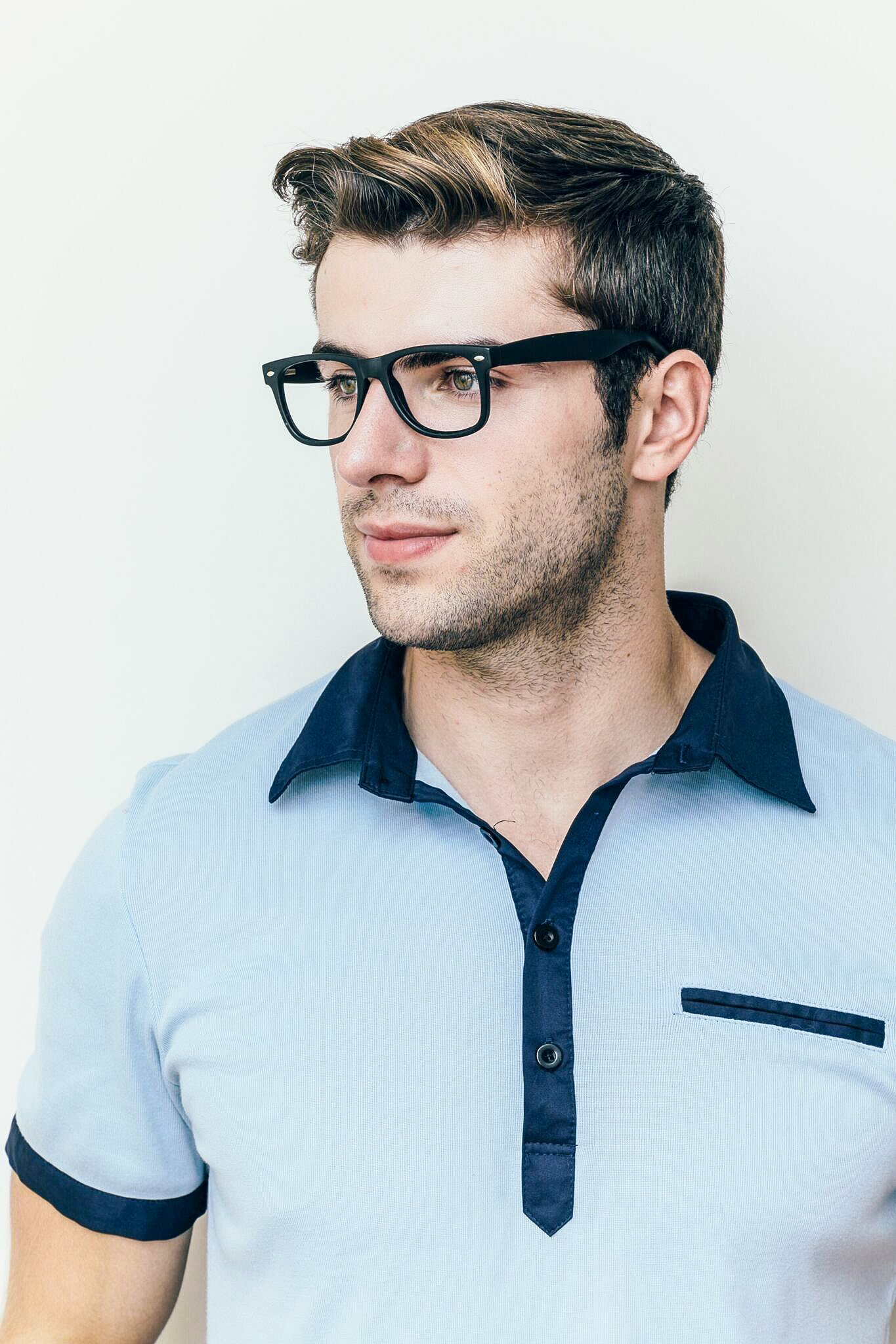 brunette man wearing plastic black glasses