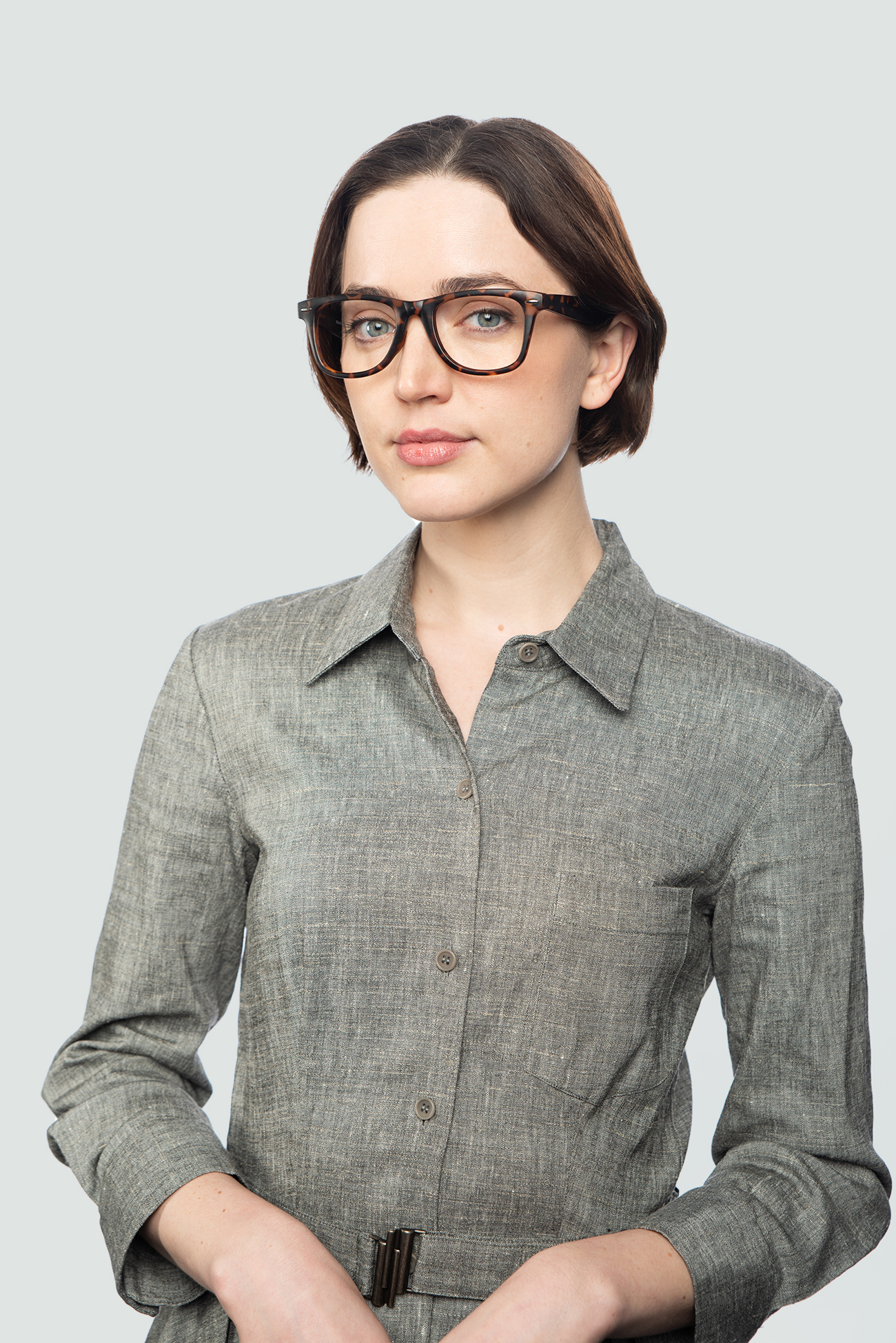 brunette woman wearing tortoise matte glasses