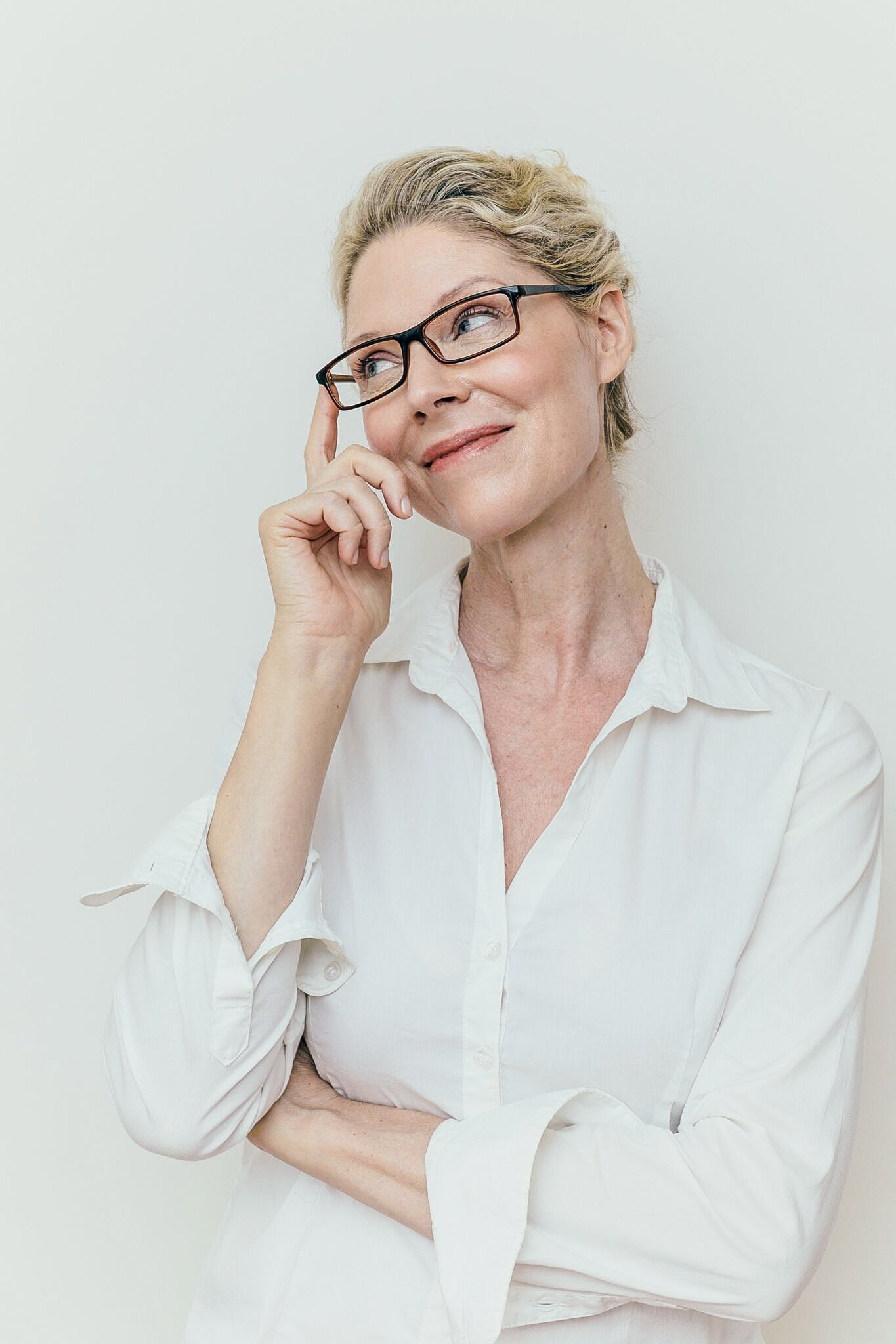 blonde woman wearing plastic black frames