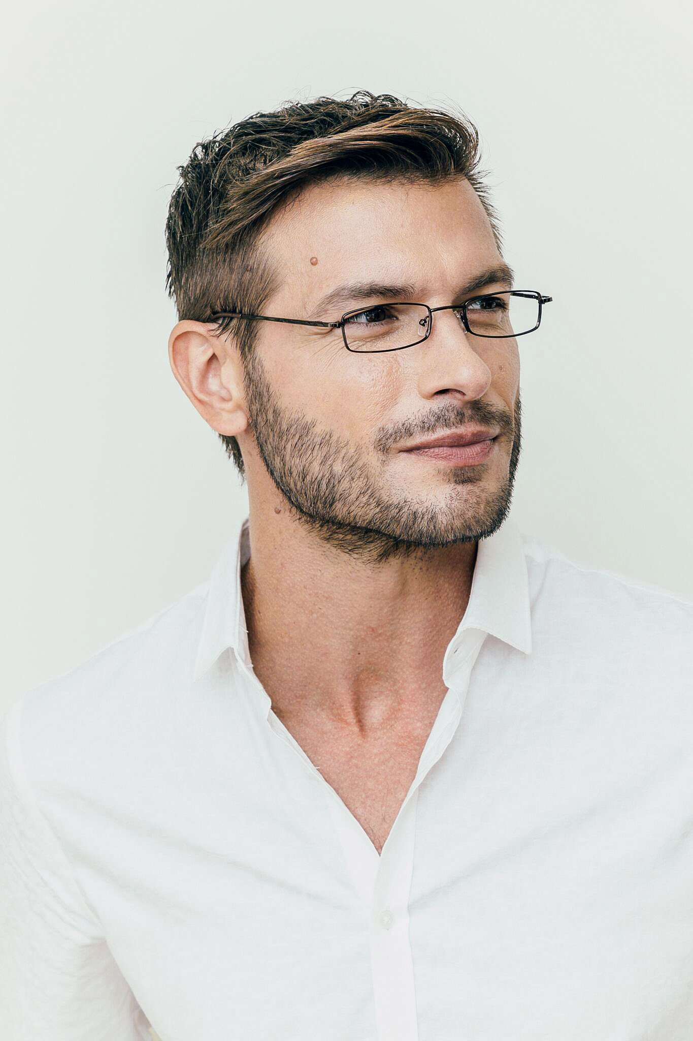 brunette man wearing metal brown glasses