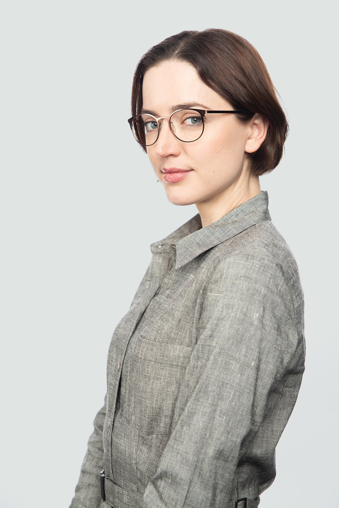 brunette woman wearing metal brown glasses