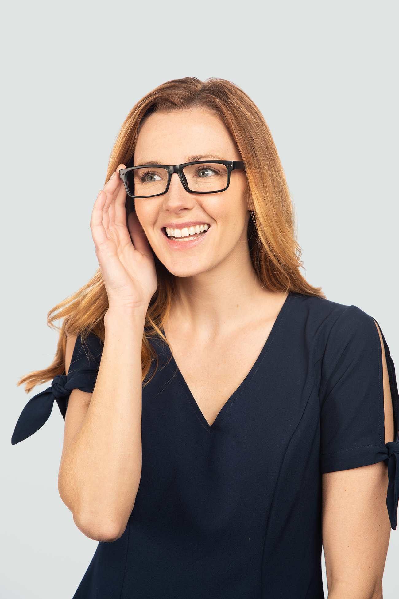 red head woman wearing black plastic glasses