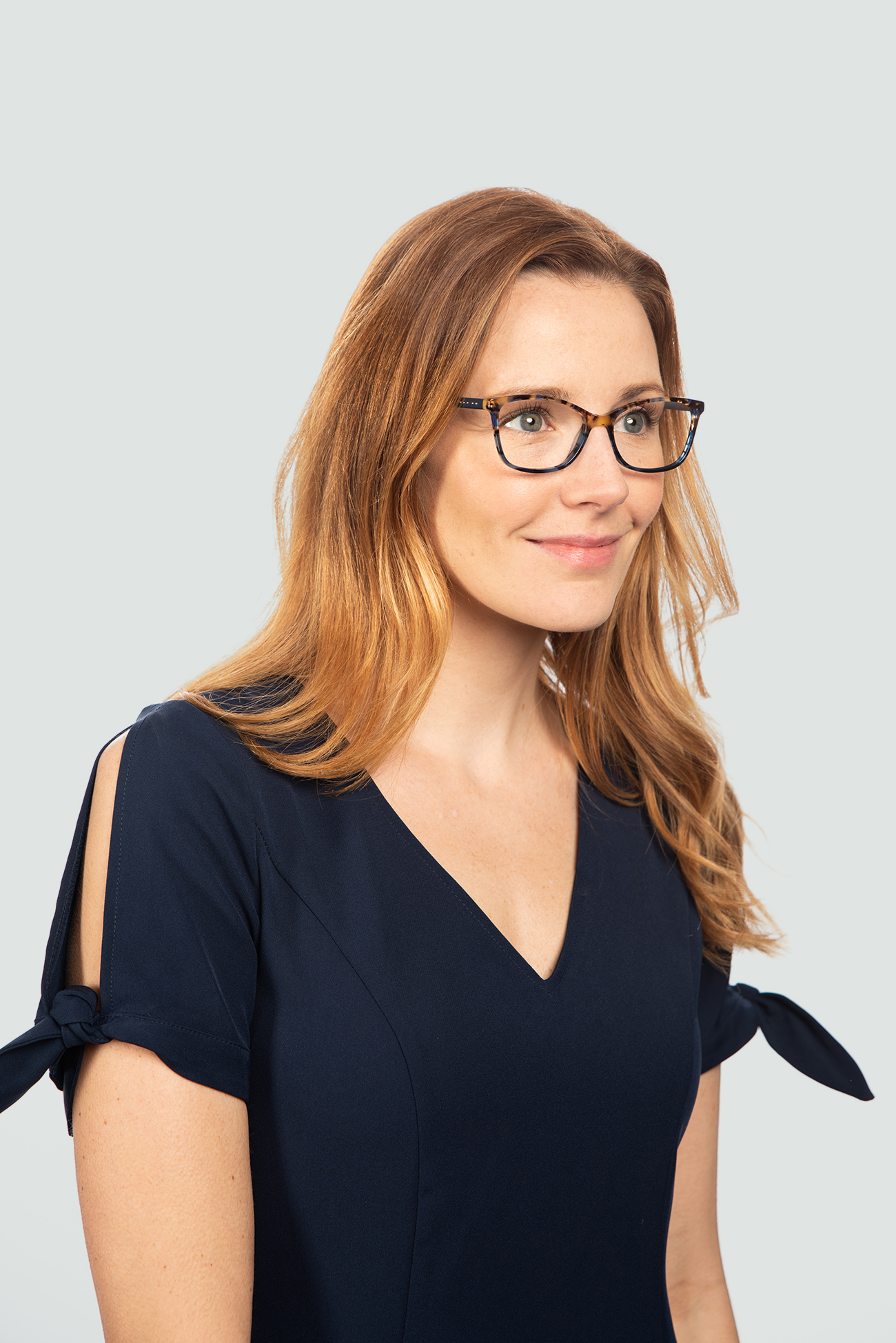 red head woman wearing red plastic glasses