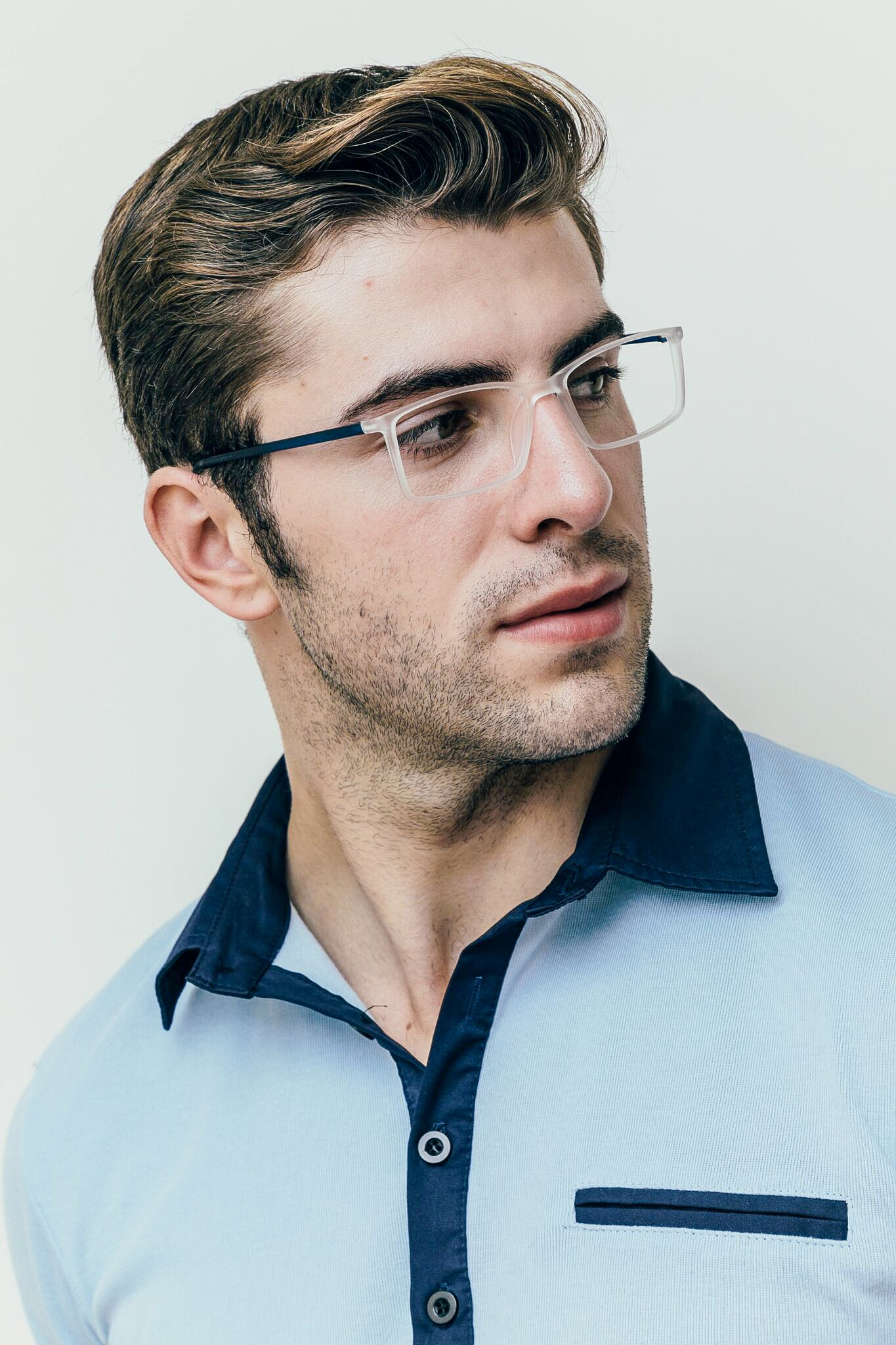 brunette man wearing matte white and blue glasses