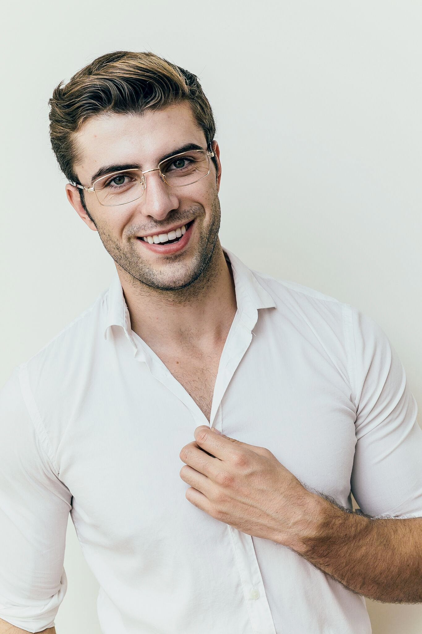 brunette male wearing metal gold astoria frame