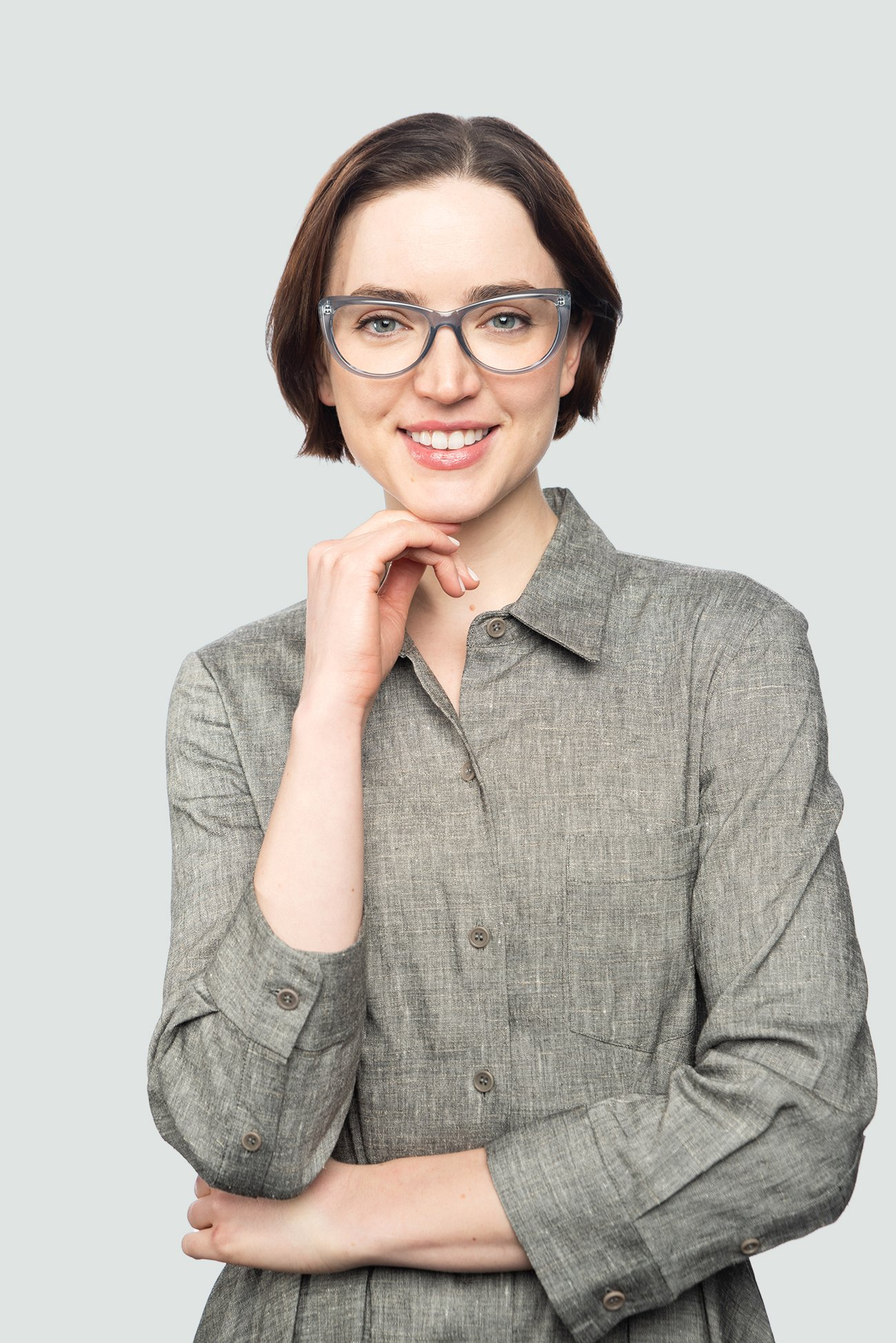 brunette woman wearing blue crystal plastic glasses