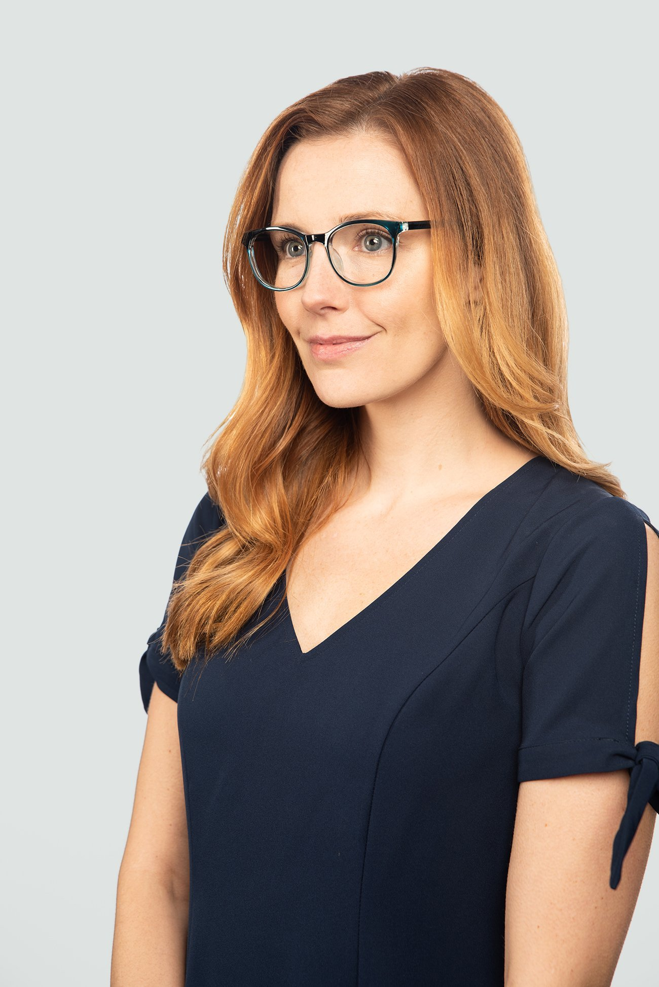 red head wearing plastic blue glasses