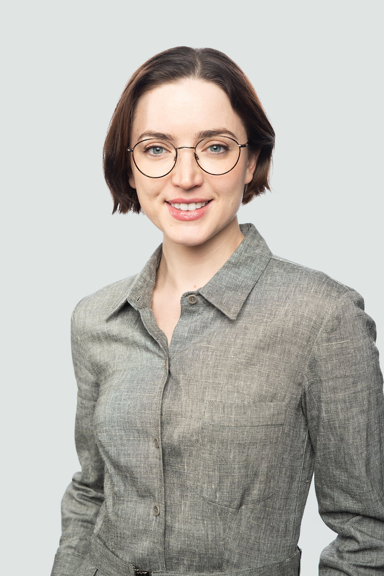 brunette woman wearing metal tortoise glasses