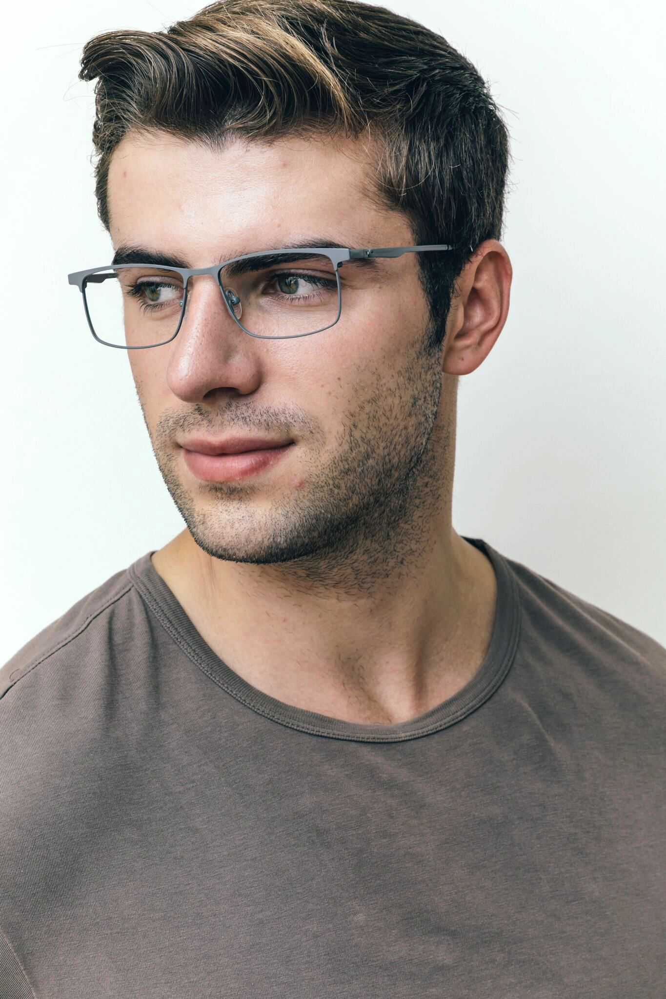 brunette man wearing gray metal frames
