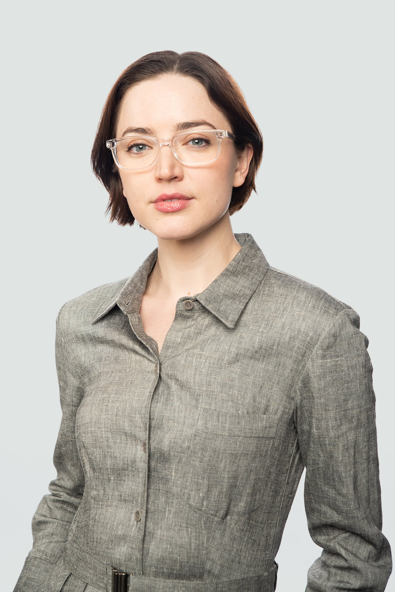 brunette wearing plastic crystal glasses