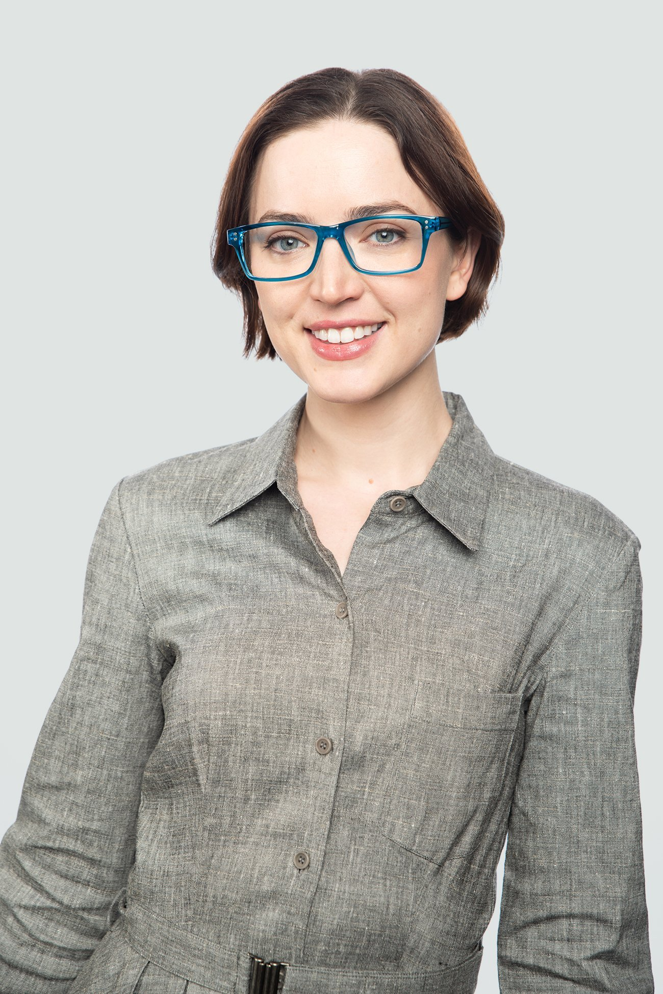 brunette woman wearing plastic blue glasses